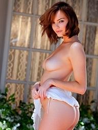 Dakota Rae gets undressed in a garden - Digital Desire